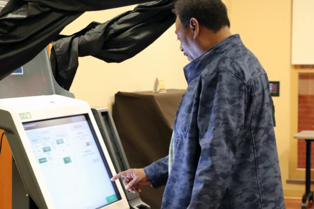 A local resident examines an ExpressVote XL during a public voting machine demonstration in March 2020, prior to pandemic restrictions. Photo courtesy of Cumberland County.