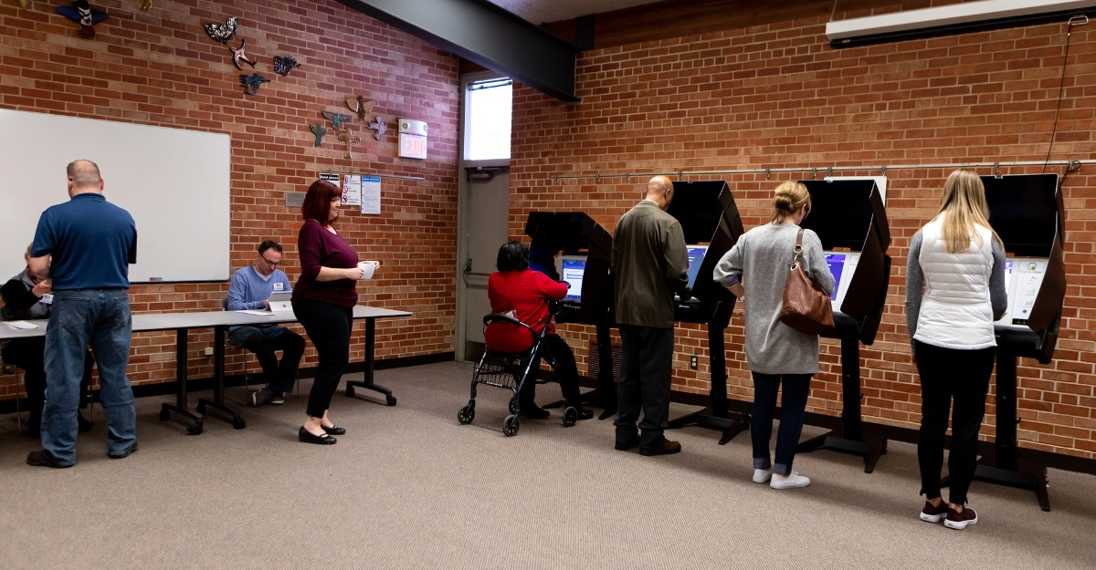 Voters checking in on ExpressPoll and voting on ExpressVote kiosks