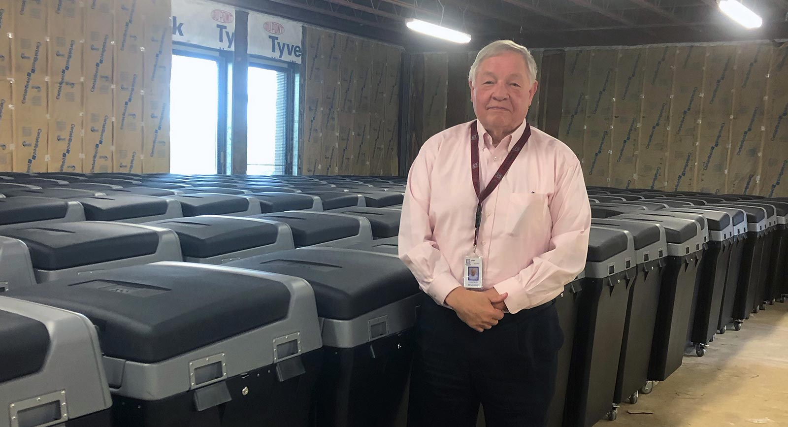 Conway Belangia, Greenville County's Director of Voter Registration and Elections with rows of locked DS200 units.